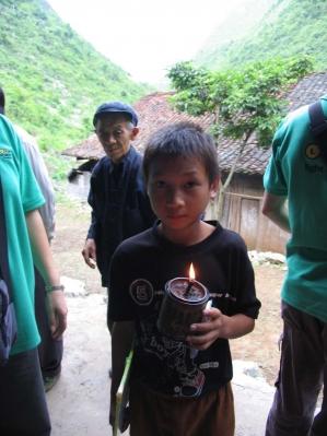 boy holding kerosene lamp